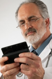 Doctor texting on smartphone